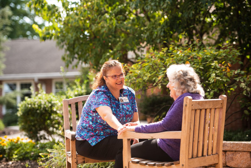 Landis homes employee and resident talking outdoors