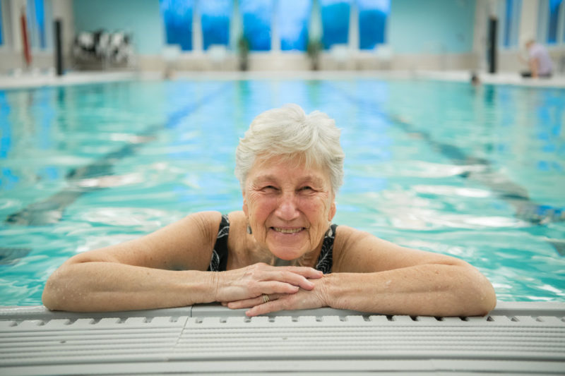 senior woman smiling in the pool